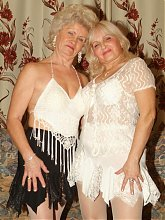 Francesca and Erlene are sexy older women stripping off their clothes and making out live