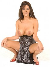 Sexy milf Kylie flaunts her enormous jugs and playing with her strap on cock live