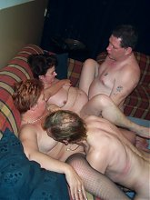 Horny mature swingers fucking and sucking