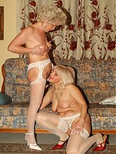 Lesbian grannies Francesca and Erlene play with pussies and later pound it with a kinky sextoy