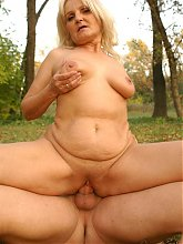 Explicit live cam show with a chubby GILF riding a younger guys dick in the woods