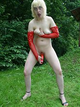 Explicit live cam show with a chubby mature model masturbating outdoors with a huge dildo